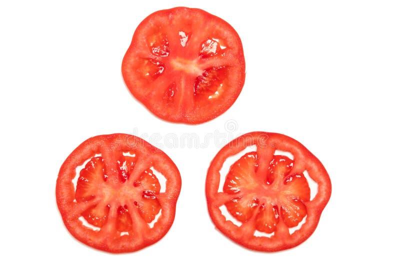 Schneiden Sie rote reife Tomate lokalisiertes Draufsicht-, Obst- und Gemüse Konzept stockfoto