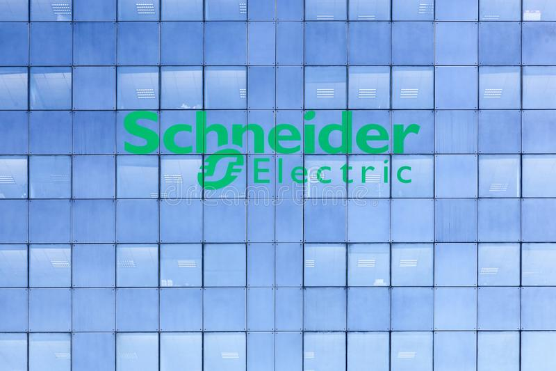 Schneider Electric building with the logo on a facade. Grenoble, France - June 25, 2017: Schneider Electric building with the logo on a facade. Schneider stock image