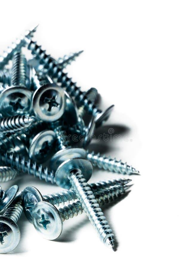 Schneidschrauben hergestellt vom Stahl, Metallschraube, Eisenschraube, Chromschraube, Schrauben als Hintergrund, Holzschraube Lok lizenzfreie stockfotos