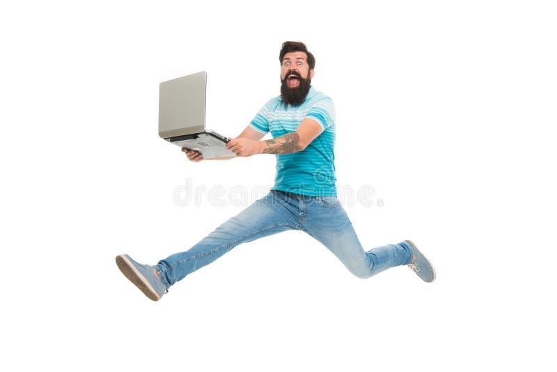 Schnelles Internet Laufende Welt der Technologien Mannlauf mit dem modernen Laptop gefangen genommen in der Bewegung Stoppen Sie  stockbild
