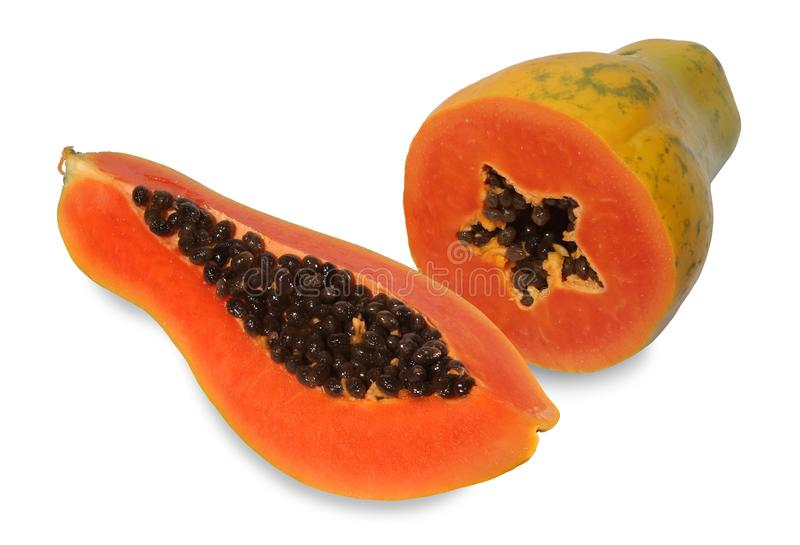 Schnitthälfte mit zwei Papayas stockfotos