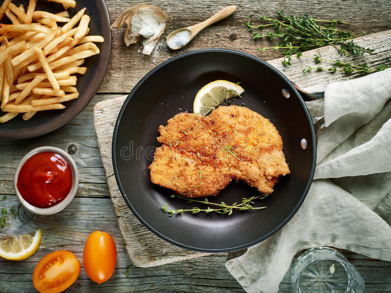 Schnitzel on cooking pan royalty free stock photos