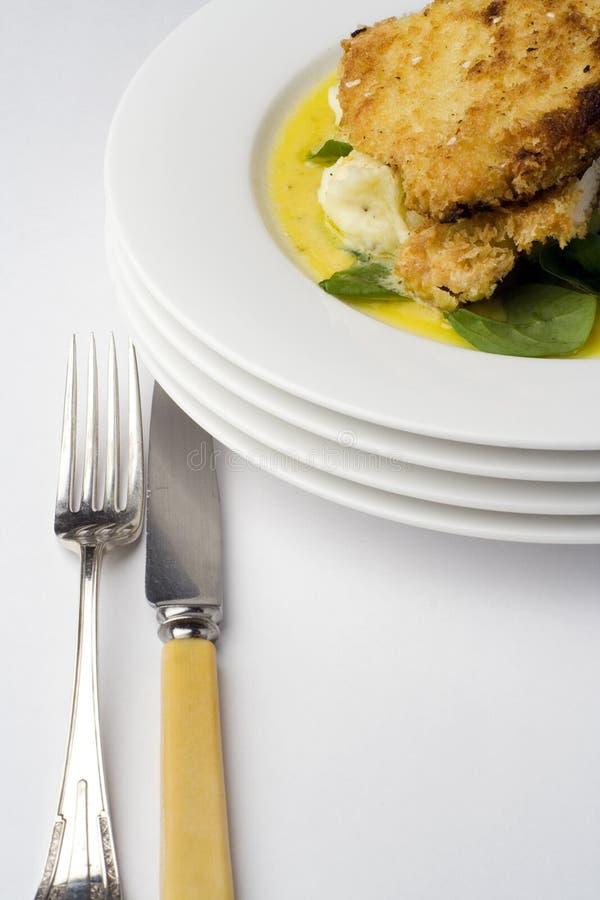 Costeleta de carneiro da galinha; com faca e forquilha imagem de stock