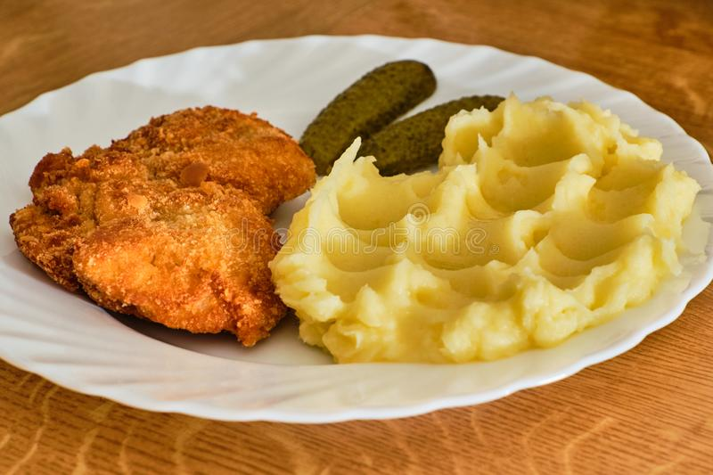 Schnitzel with mashed potatoes royalty free stock photography
