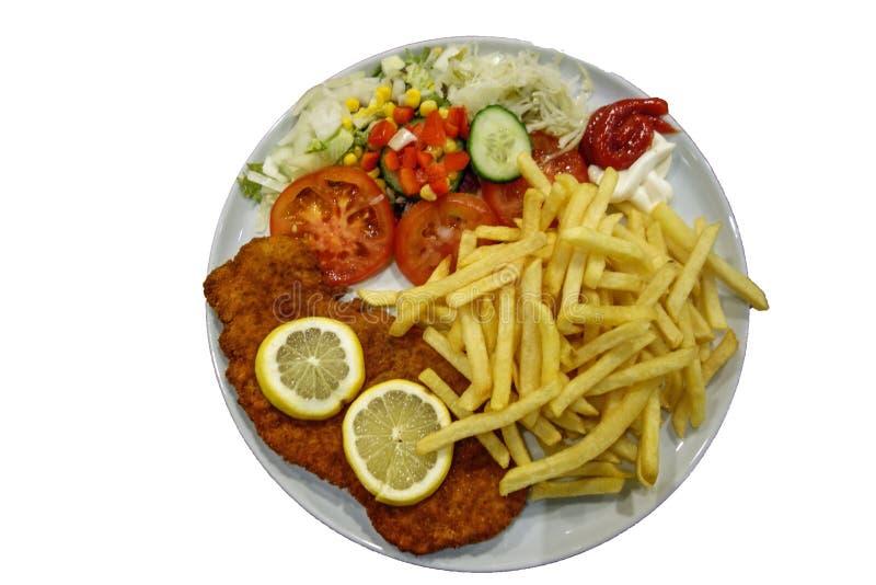 Schnitzel met frieten en salade royalty-vrije stock afbeelding