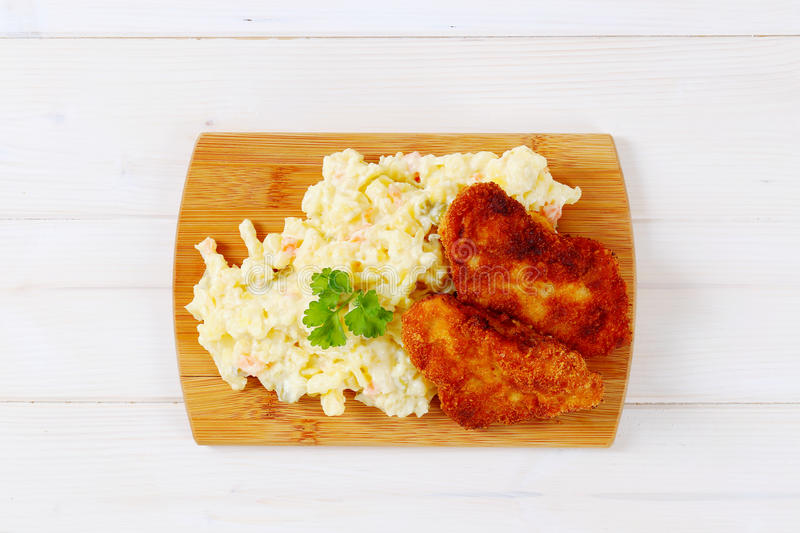 Download Schnitzels With Potato Salad Stock Image - Image of white, board: 83708339