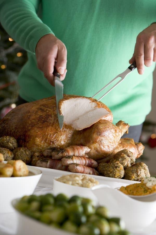 Schnitzen des Weihnachtsbratens die Türkei lizenzfreies stockfoto