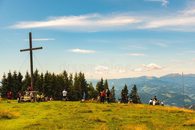 Families and tourists at the Schockl mountain next to the cross at the peak. Tourist destination stock photos