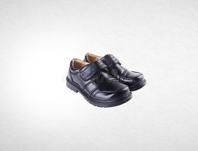 schoen of jongensschoenen op een achtergrond stock afbeeldingen