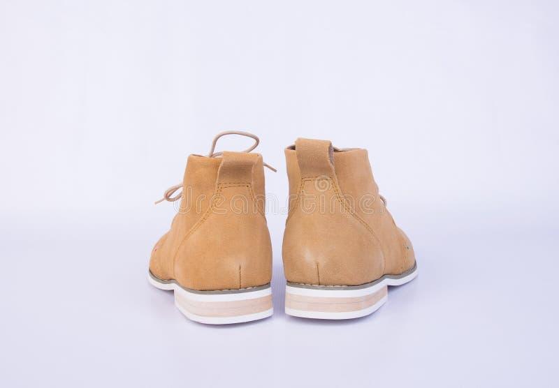 schoen of van bruine verfhandelaars schoenen op een achtergrond stock fotografie