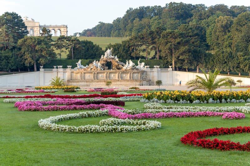 Schoenbrunn Palace Garden Gloriette and the fountain in Vienna, Austria. Vienna, Austria - September 3, 2019: Schoenbrunn Palace Garden Gloriette and the stock images