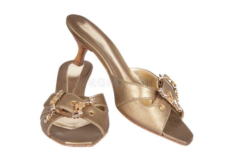 Schoenen van gouden kleur stock afbeeldingen