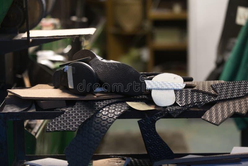 Schoenmakersworkshop stock afbeelding