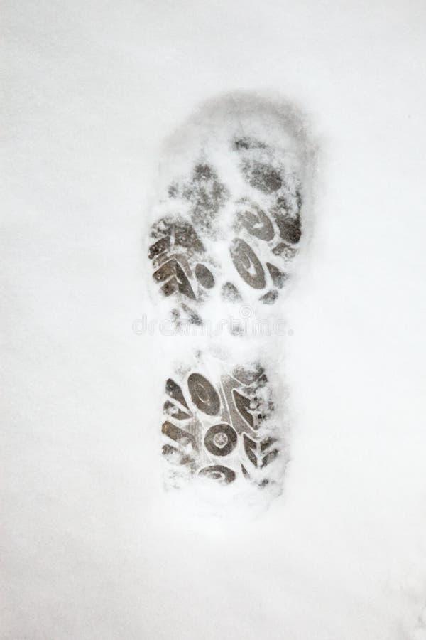 Schoenvoetafdruk in sneeuw royalty-vrije stock foto