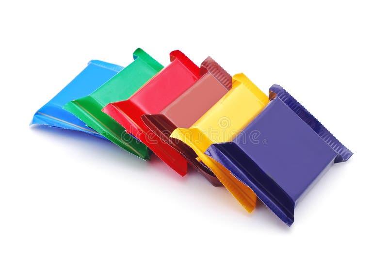 Schokolade in den bunten Verpackungen lizenzfreies stockbild