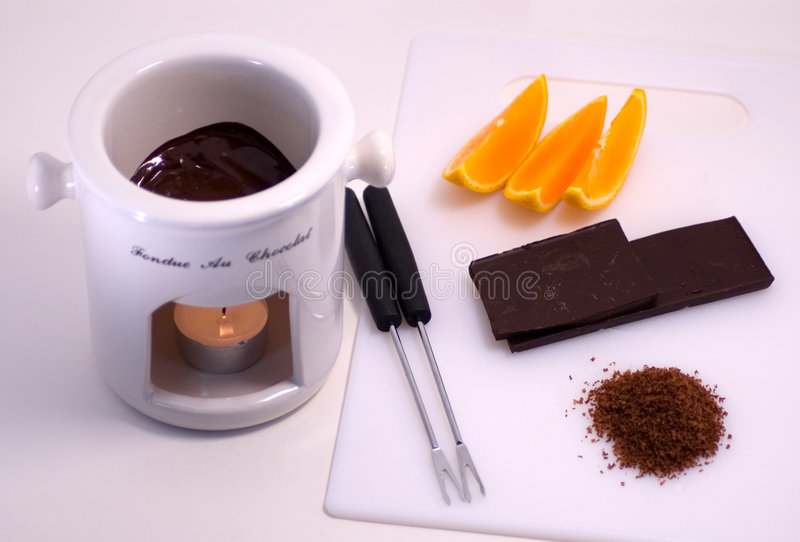 Schokoladen-Fondue mit Orangen lizenzfreies stockfoto