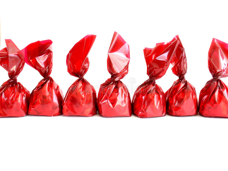 Schokoladen im Rot lizenzfreies stockfoto