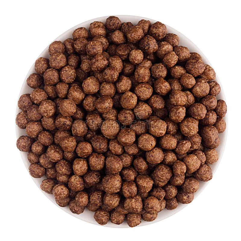 Schokoladenball-Corn Flakes in der weißen Schüssel lokalisiert, Draufsicht getreide lizenzfreie stockbilder
