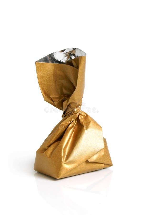 Schokoladenbonbon in der goldenen Folie lizenzfreies stockbild