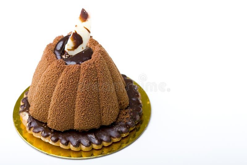 Schokoladencremekuchen auf einem Verglasung Plätzchennachtisch stockbild