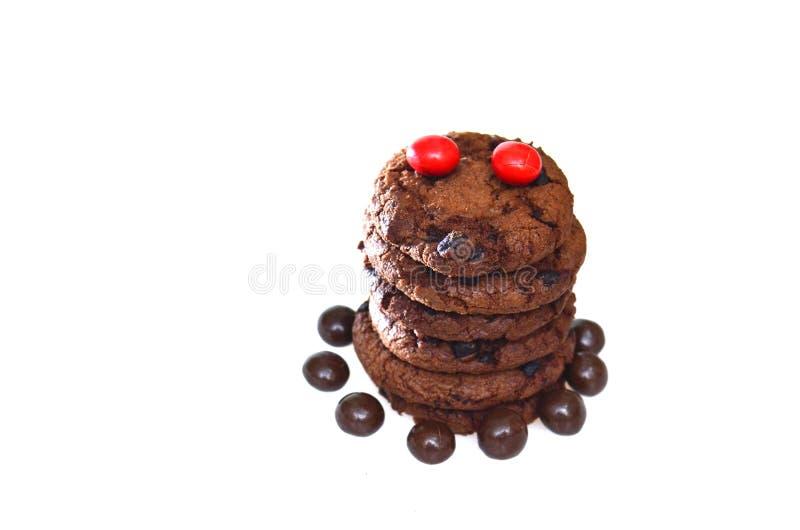 Schokoladenkekse plus die Rosinen, rund mit einer rauen Beschaffenheit stockfotografie