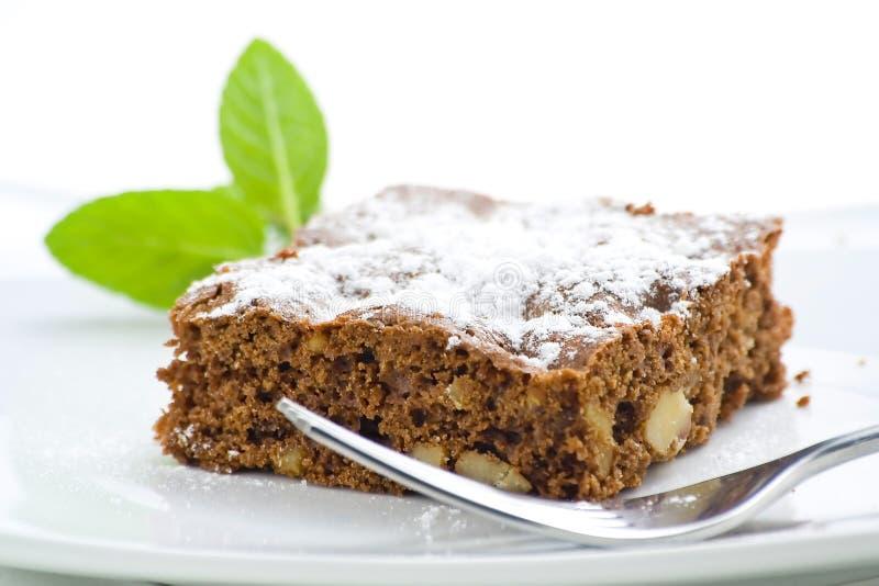 Schokoladenkuchen der heißen Schokolade mit Walnüssen und Vanille stockfotografie