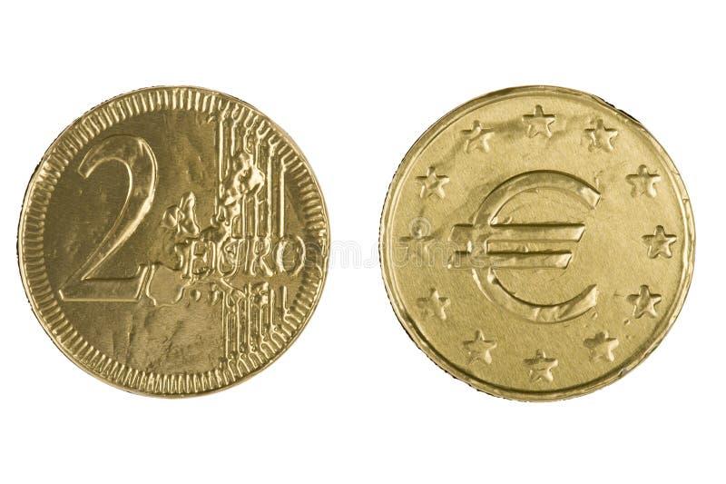 Schokoladensüßigkeitmünze auf Weiß lizenzfreie stockfotos