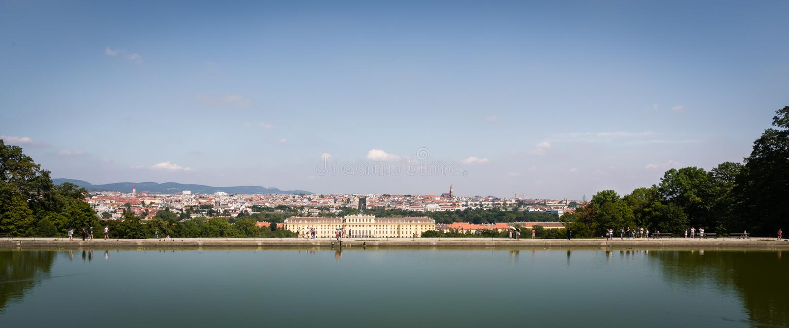 Schonbrunn palace and city of vienna viewed from the pond on the hill. A historic and heritage site in Vienna with the Baroque garden royalty free stock photography