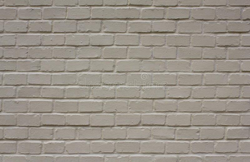 Schone grijs-witte bakstenen muur met schaduwen Ruwe Oppervlaktetextuur royalty-vrije stock fotografie