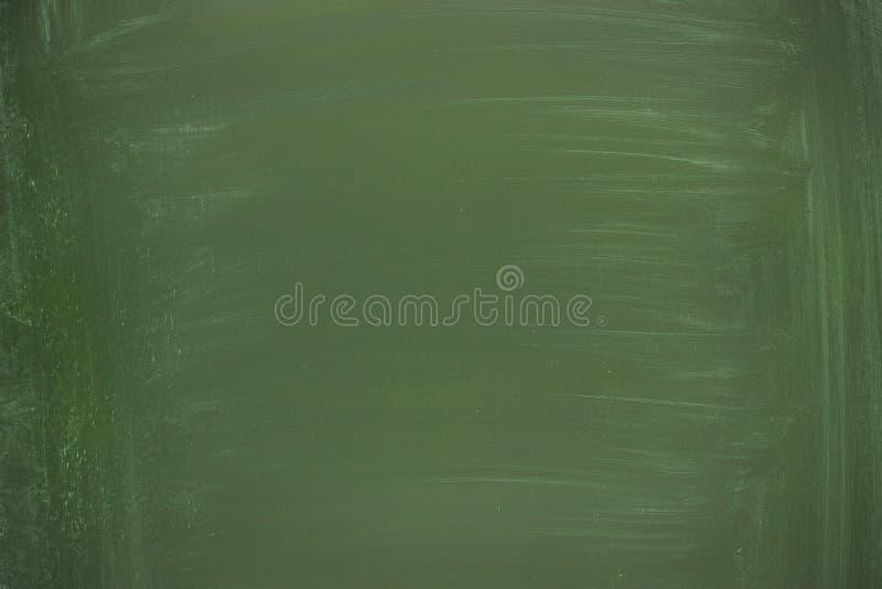 Schone schoolraad voor krijt, groen bord als achtergrond stock foto