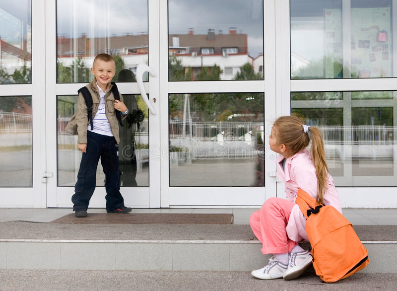 School. Pupils in front of the school royalty free stock image