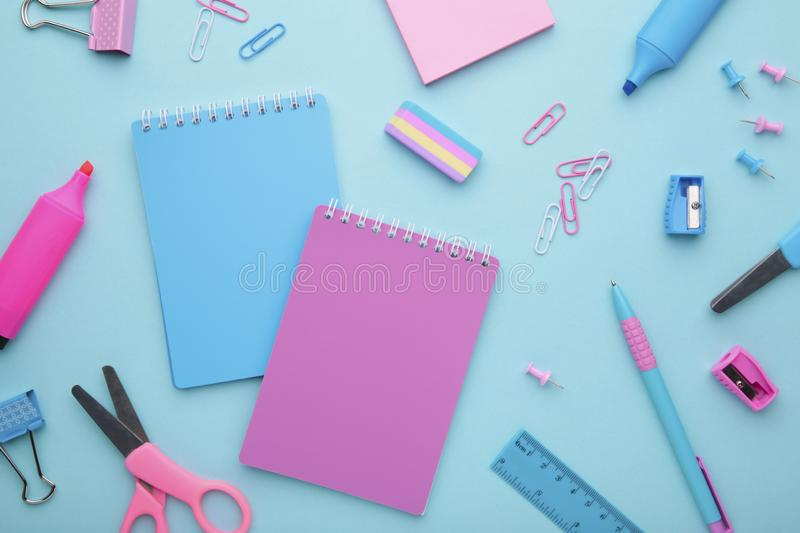 School accessories on blue background. Back to school concept, minimalism stock photos