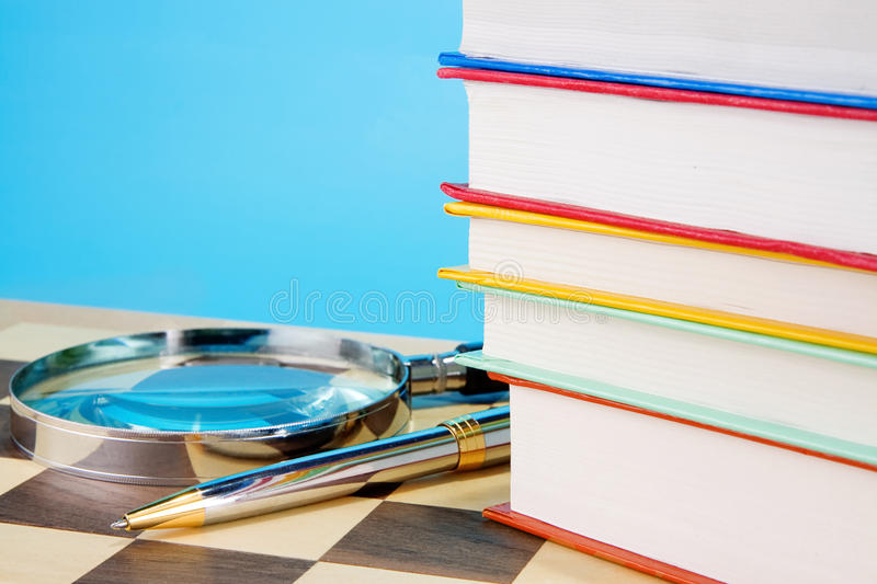 School Accessories And Checked Notebook On Wood Stock Image