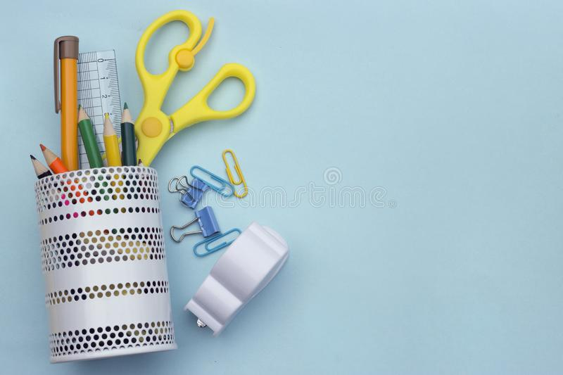 School accessories on soft blue background. Back to school concept. Creativity for kids. Colorful school background. top view, cop. Y space stock photo