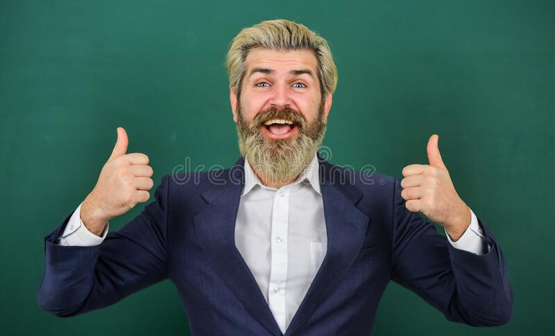 School advertisement concept. Inspiring quotes. Introduced and welcomed by university. Teacher explain topic. Man. Teacher in front of school chalkboard copy stock images