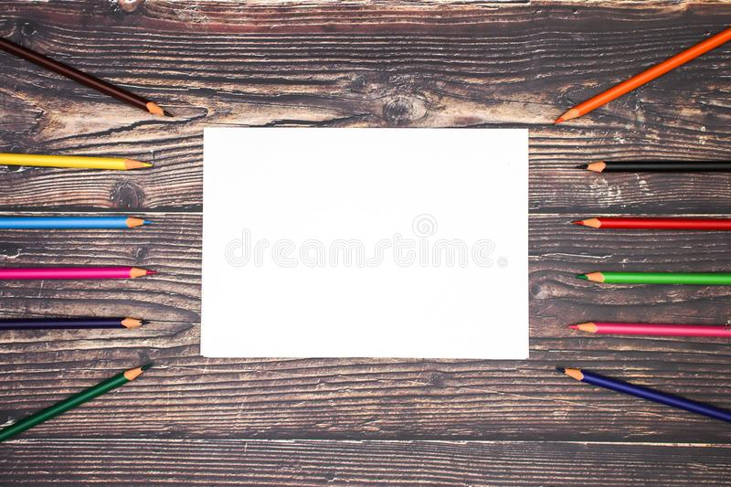School and art supplies on wooden background stock images