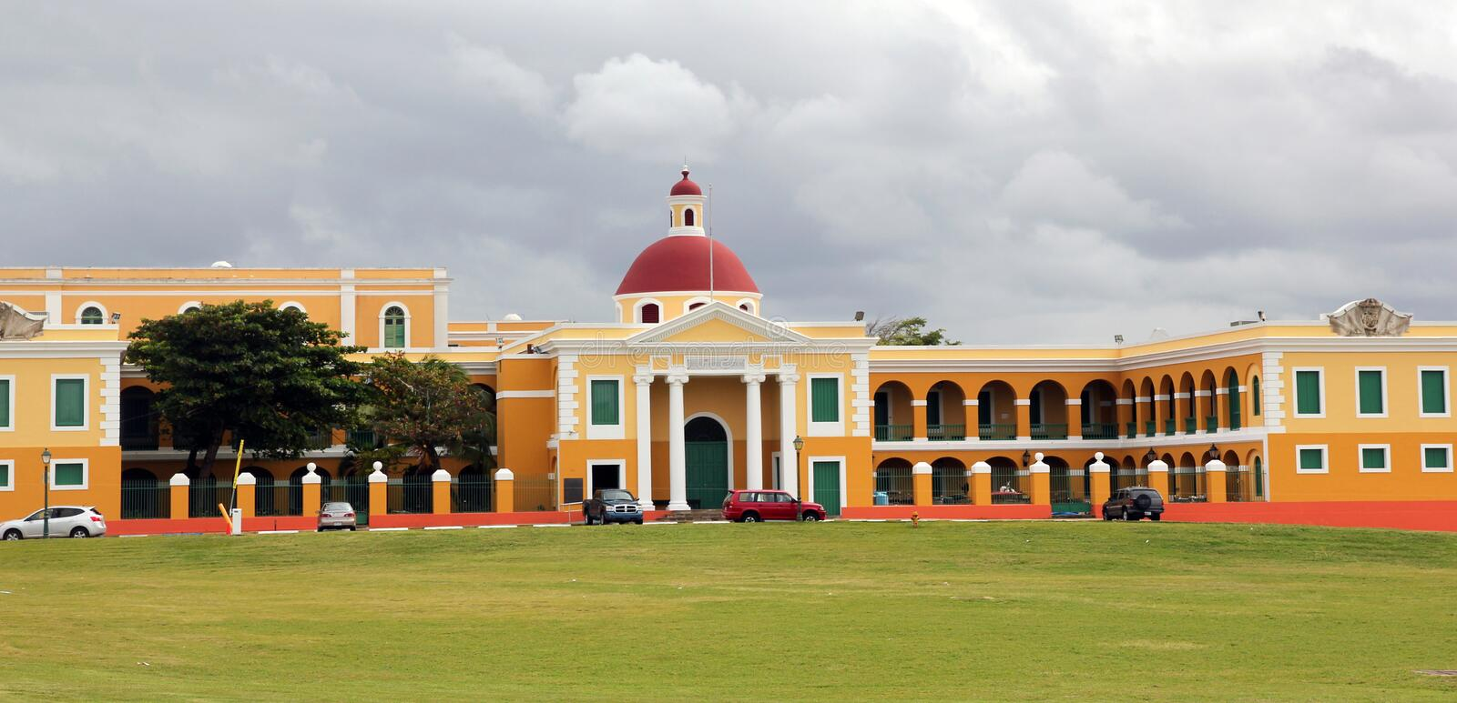 School of Arts in Puerto Rico. Colorful university building with dramatic gray sky in Old San Juan in Puerto Rico stock image