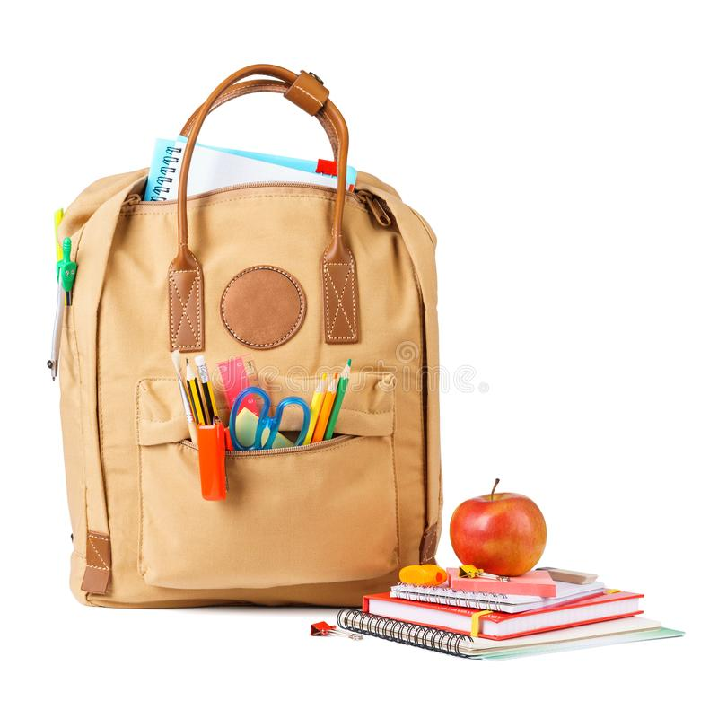 School backpack full of various stationery. Isolated. stock photography