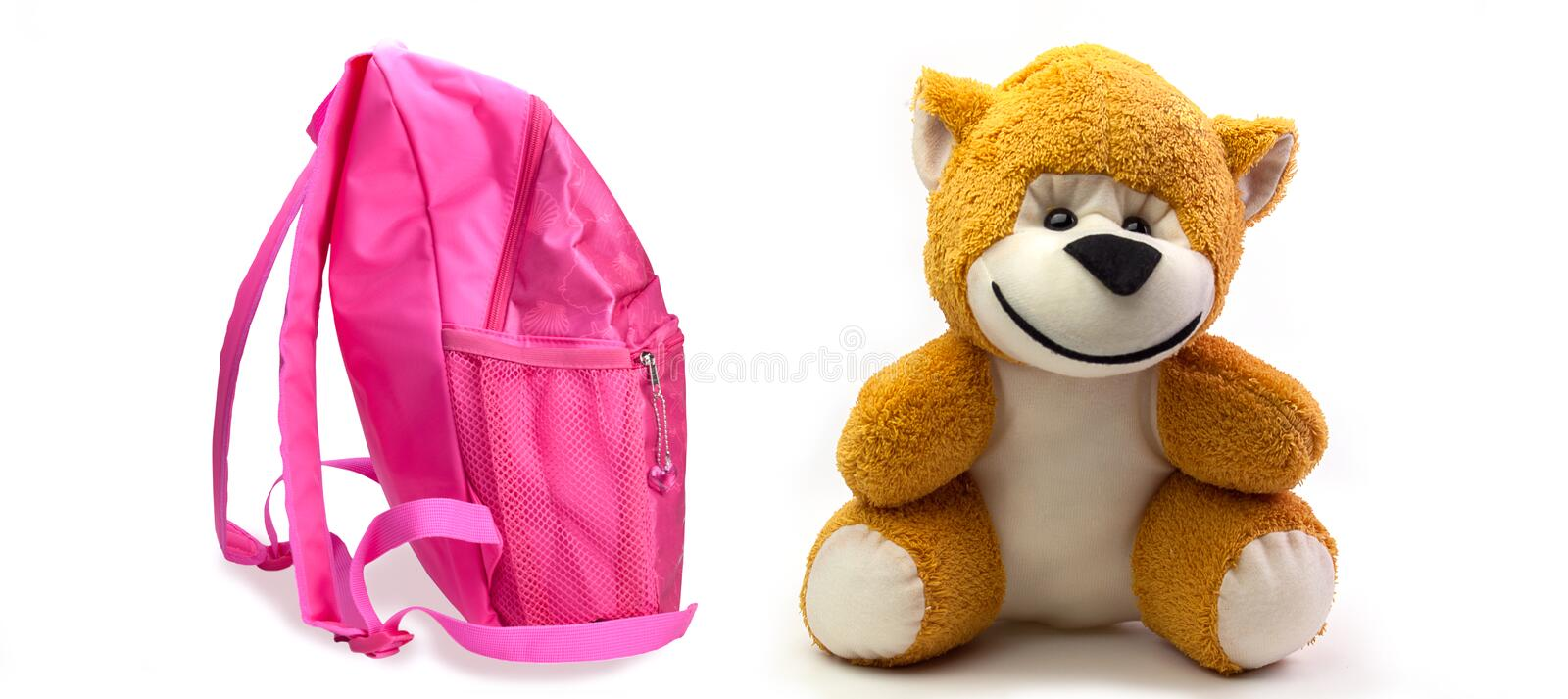 School backpack for girls and monkey toy. On white background stock photography