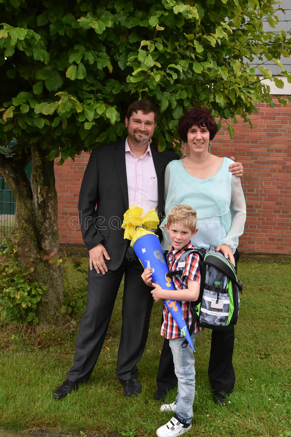 School beginns. Back to school, a new life begins , little boy and his parents at his first day at school royalty free stock photos