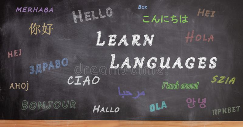 School blackboard written with hello in different languages stock photos