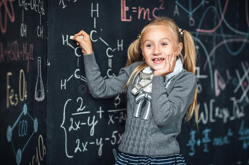 School board, math formula, schoolgirl with very surprised face stock photography