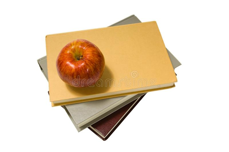 School books and apple stock photography