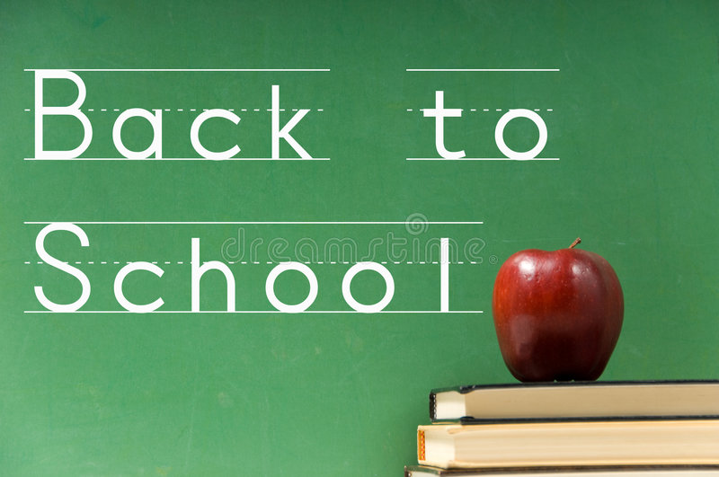 School books and chalkboard royalty free stock photography
