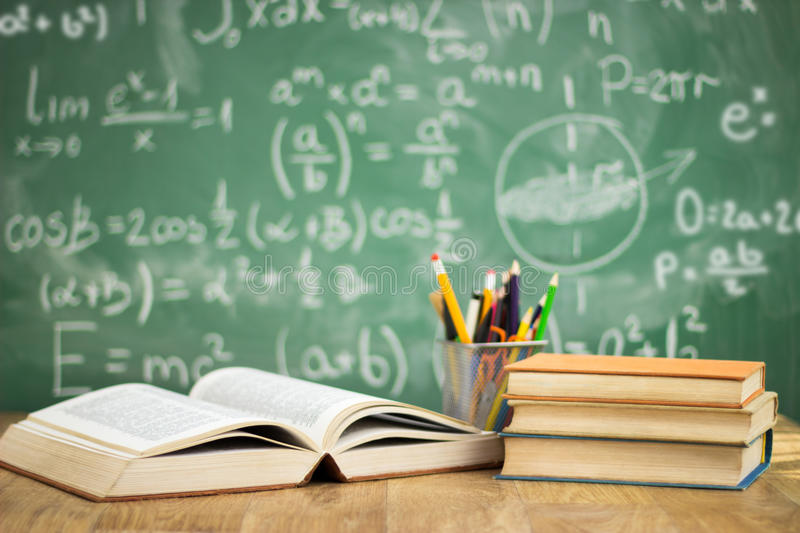 School books on desk royalty free stock photo