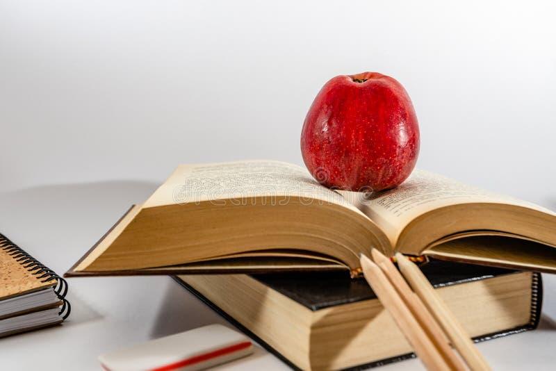 School books on desk. white background stock photography