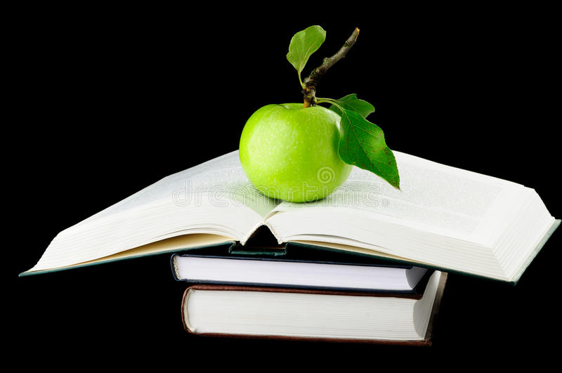 School Books and green apple. School Books With Apple Isolated On black Background royalty free stock photos