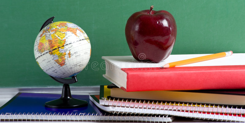 School Books a red Apple and a Globe royalty free stock images