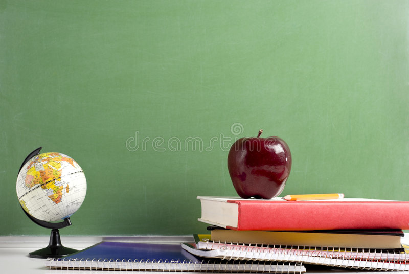 Download School Books A Red Apple And A Globe Stock Photo - Image: 6878970