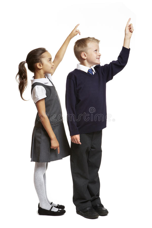 Free School Boy And Girl Pointing Stock Photography - 26234982